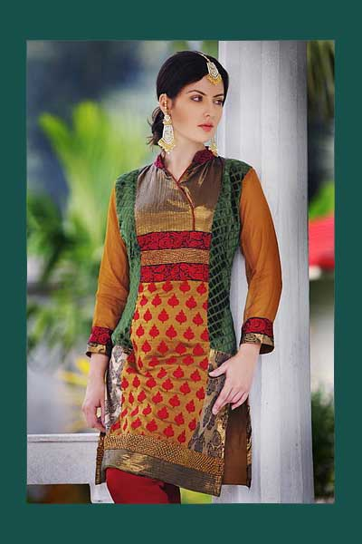 Orange Chudidar Kameez with net sleeves and embroidery work