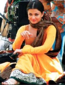 ash in yellow shalwar kameez