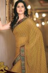 Latest Saree Fashion 2010 with yellow dotted saree