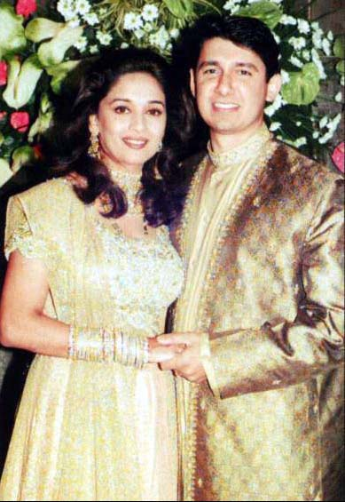 madhuri dixit in golden lehenga choli
