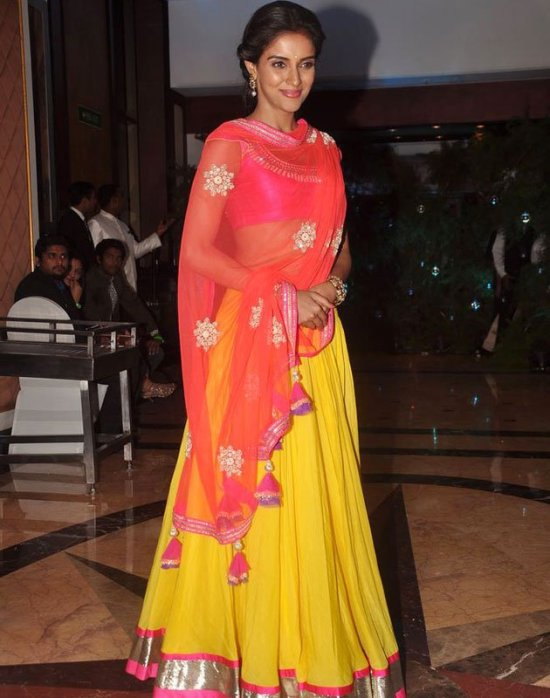 asin in a bright yellow lehenga choli at genelia ritesh sangeet ceremony