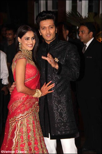 genelia in red lehenga and ritesh in black sherwani in their wedding