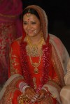 reema sen in a red lehenga choli