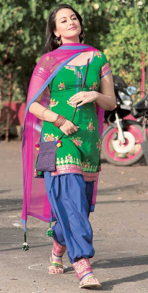 Sonakshi wearing a colorful salwar suit in Rowdy Rathore