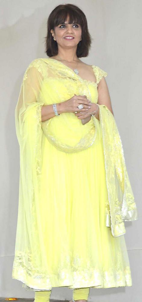 Designer Neeta Lulla in a lemon yellow anarkali