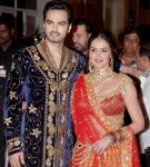 the couple looking beautiful in their attire