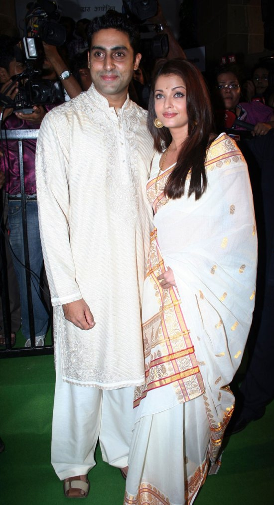 Ash-Abhi in off white traditional attires