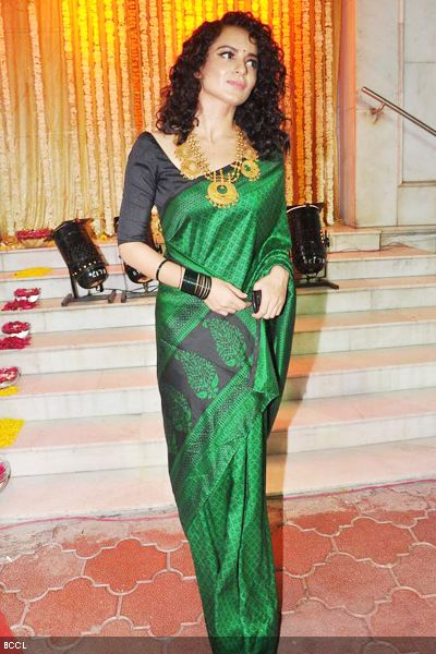 Kangna Ranaut at wedding in a gorgeous green saree