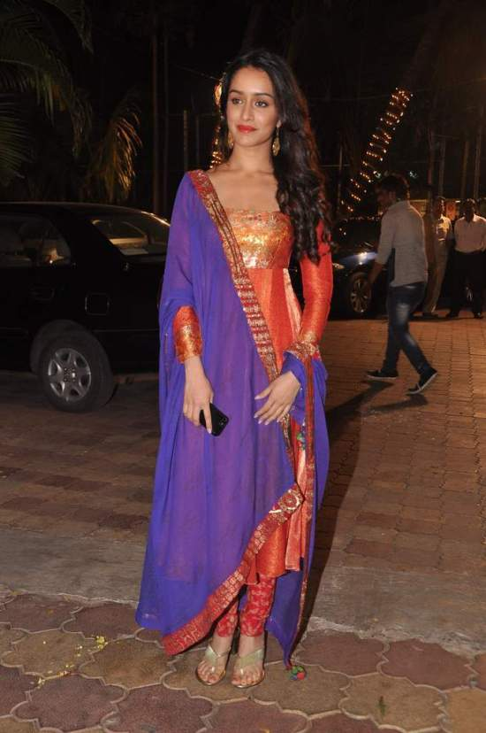 Shraddha Kapoor splashed with a purple salwar kameez