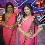 Shilpa in a block neon pink saree