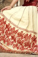http://www.sareez.com/Sarees/By-Fabric/Jacquard-Sarees/Cream-Yellow-Chiffon-and-Jacquard-Embroidered-Lehenga-Style-Saree-82511/