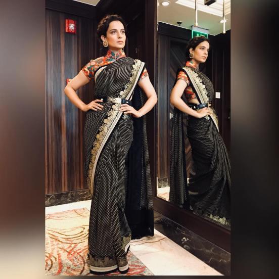 Kangana wearing black saree