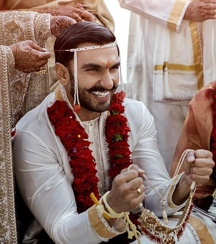 Ranveer with white silk kurta with a perfect silk dhoti.